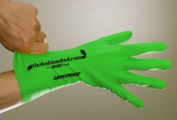 Man putting on rubber glove